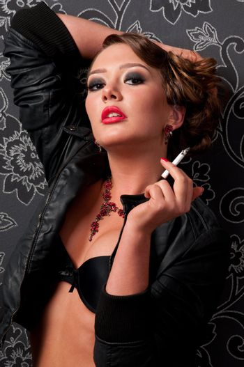 Close-up portrait of glamour woman with cigarette