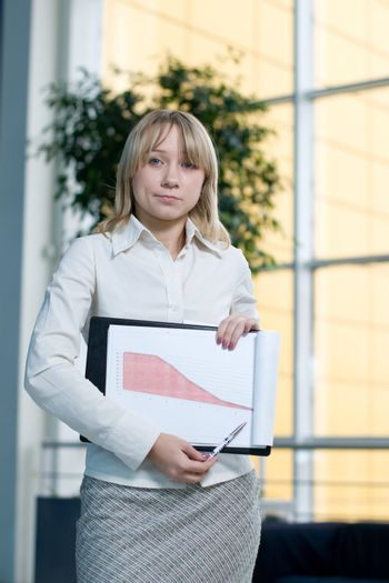 Young businesswoman show charts