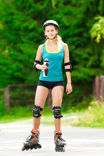 Young brunette woman on roller skates