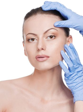 Beautician touch and exam health woman face