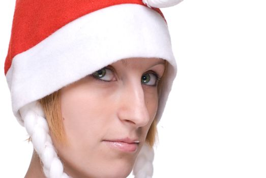 Close up portrait of girl in santa claus hat