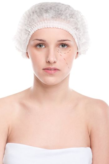 Beautician draw correction lines on woman face