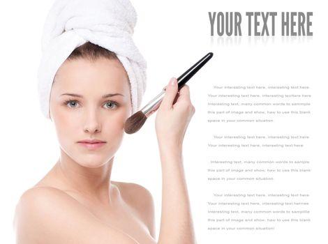 Beautiful woman with make up brush