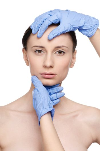 Beautician touch and exam health woman face.