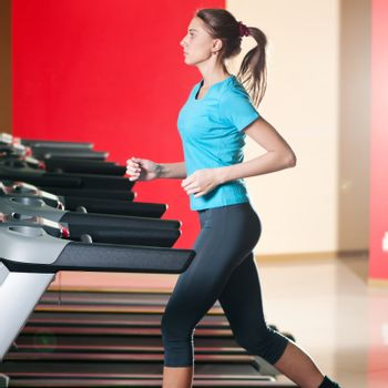Gym exercising. Run on on a machine.