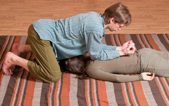 Couple doing yoga. Massage