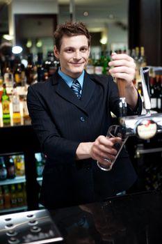 Bartender preparing to make cocktail