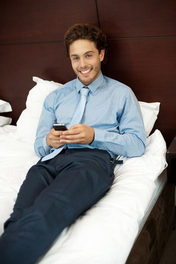 Adorable gentleman reading text sms on phone