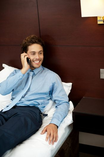 Relaxed cool guy talking on the phone