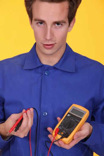 Young man with a multimeter