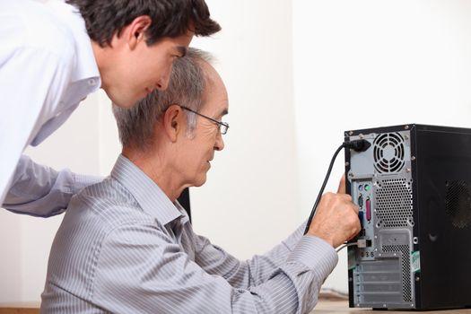 senior installing computer
