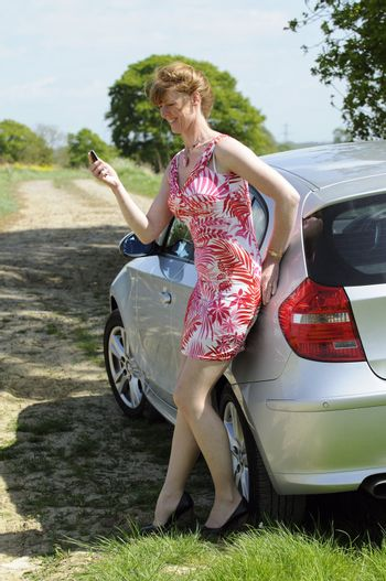 Woman motorist using a mobile telephone