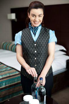 Female attendant serving beverages