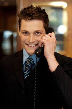 Well dressed gentleman attending phone call