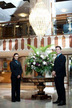 Executives posing under a chandler