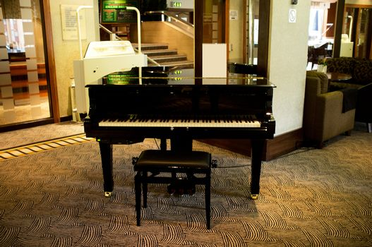 Piano in the middle of massive lounge