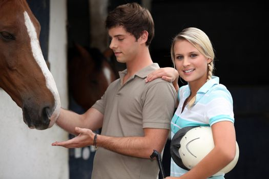 Teens in riding stables