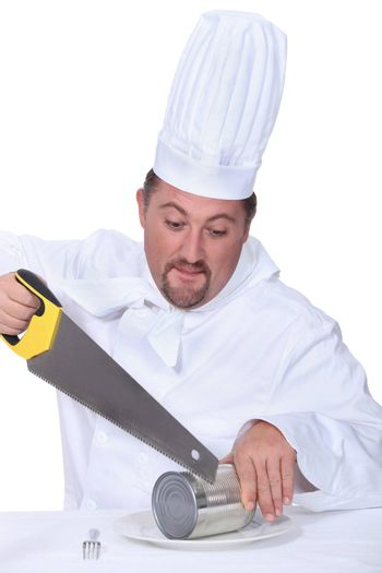 Chef sawing tin