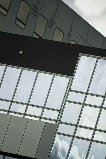 View of a modern and shiny glass skyscraper.