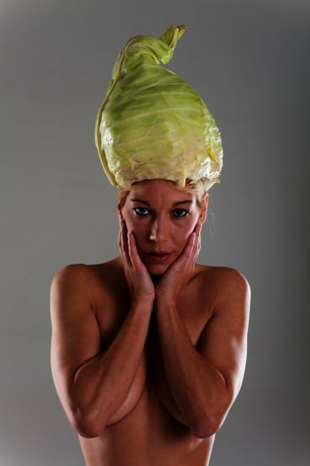 naked woman with pointed cabbage