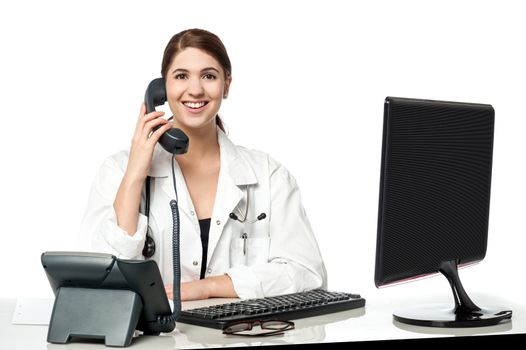 Female physician answering phone call