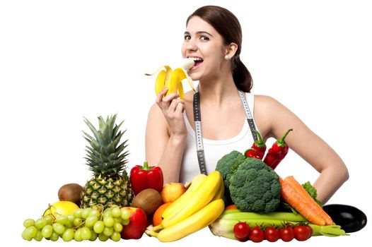 Healthy caucasian girl eating banana
