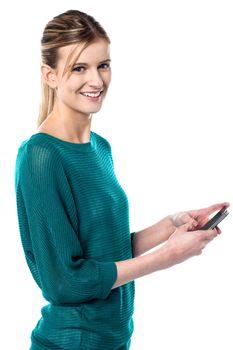 Girl sending text message through cellphone