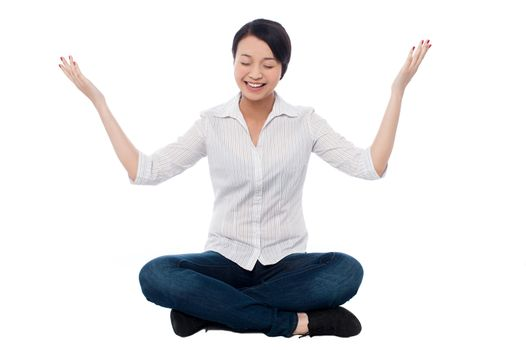 Pretty girl practicing meditation smilingly