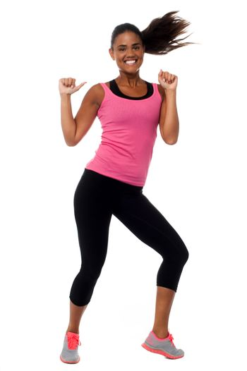 Cheerful fitness trainer filled with enthusiasm