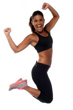 Woman in sportswear jumping with joy