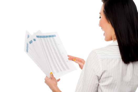 Cheerful female manager holding business reports