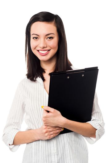 Female assistant holding business files