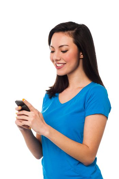 Pretty girl sending text message to her boyfriend