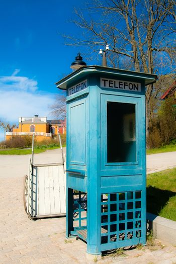 Antique telephone booth and a cart