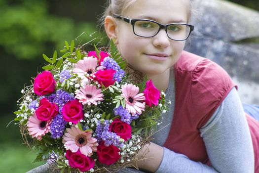 portrait of a beautiful young girl with flowers