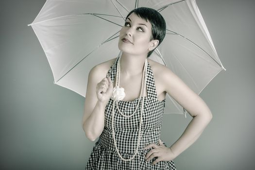 20s woman with white umbrella, pin up style