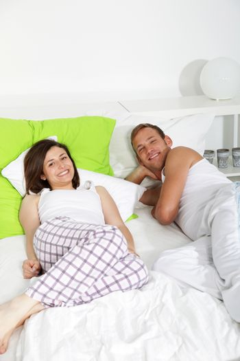 Young couple having a lazy day in bed