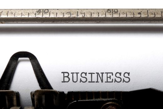 Business title printed on a vintage typewriter