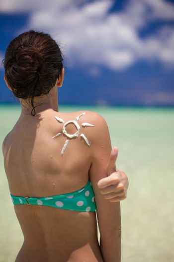Sun made with suncream at the shoulder