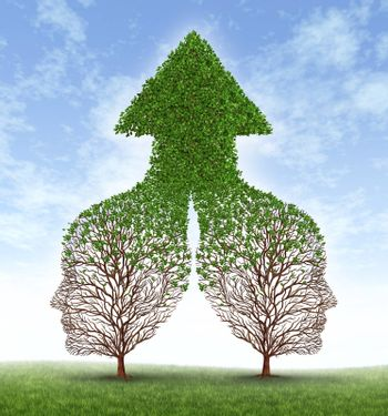 Growing together partnership with two trees in the shape of human business men heads merging as one to form a successful team resulting in fertile growth ass a leaf arrow pointing up.