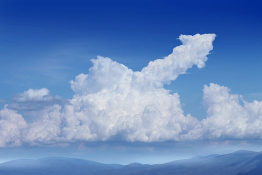 Success Dreams with a blue sky background and a cumulus cloud in the shape of an upward arrow as a financial concept for planning and dreaming about future strategy.