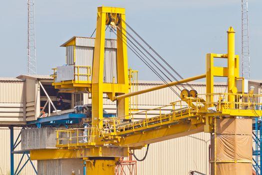 Goods on conveyor belt with crane