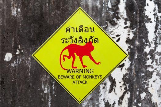 Warning sign for beware of monkeys attack