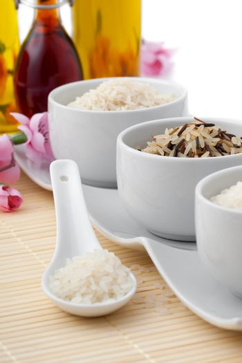 uncooked rice in porcelain spoon