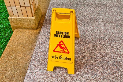Wet floor caution sign on floor
