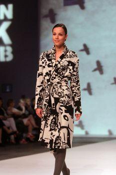 "ZAGREB, CROATIA - May 09: Fashion model wears clothes made by KATRIEN VAN HECKE on ""ZAGREB FASHION WEEK"" show on May 09, 2013 in Zagreb, Croatia."