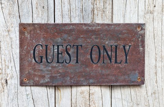 Closeup Guest Only Sign on wooden door