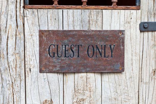 Guest Only Sign on wooden door