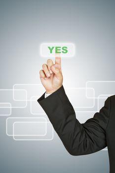 Businessman push Yes button