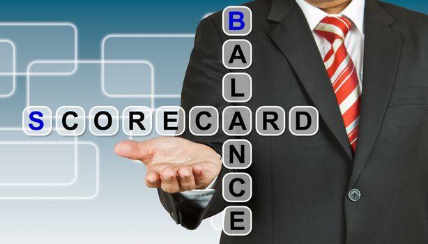 Businessman with wording Balance Scorecard